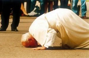Pope John Paul kissing the ground